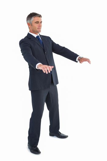 Businessman well dressed with arms out