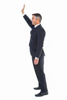 Happy businessman well dressed waving
