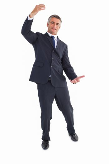 Happy businessman well dressed with arms out