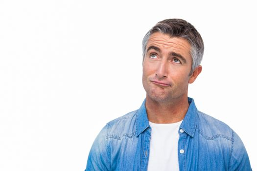 Confused man with grey hair thinking
