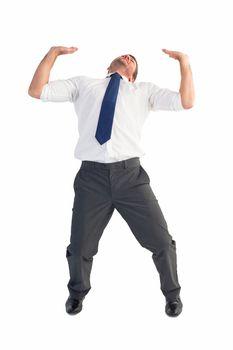 Businessman bending and pushing