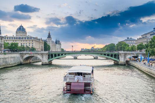 Parisian bateau on the Seine river at sunset