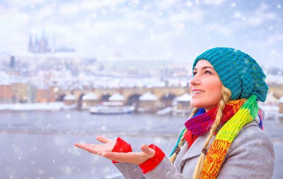 Happy woman enjoy snowfall