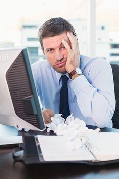 Bored businessman at his desk