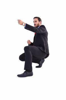 Businessman pulling something with effort