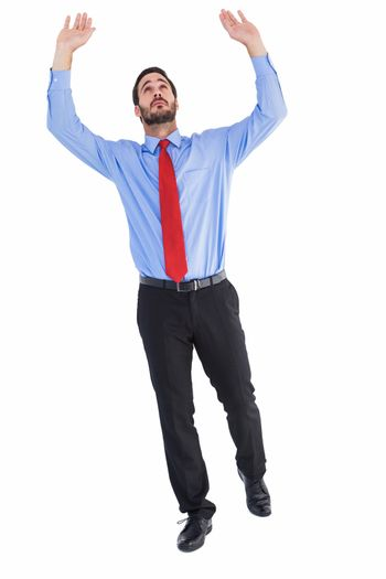 Businessman in suit pushing up with effort