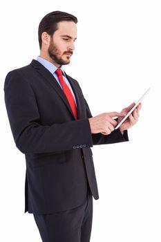 Businessman scrolling on his digital tablet