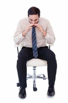 Businessman sitting on swivel chair shouting