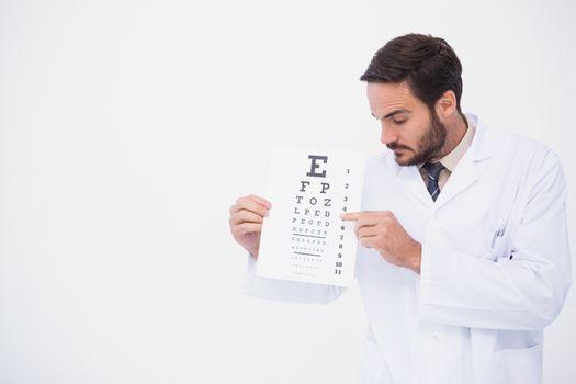 Doctor in lab coat showing eye test