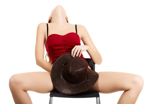 girl pleasing herself sitting on the chair, isolated on white