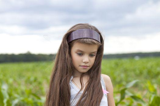 little girl running through the corn field