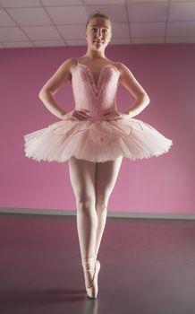 Graceful ballerina standing en pointe