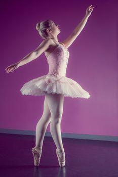 Graceful ballerina dancing en pointe