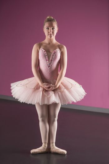 Graceful ballerina standing in first position