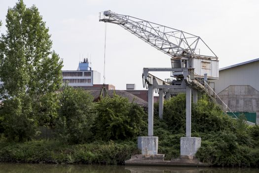 small dockside crane at river in germany