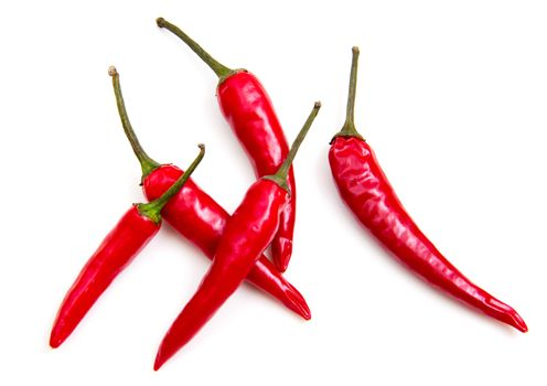 Hot peppers seen from above on white background