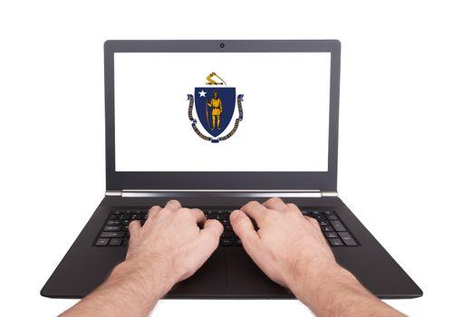 Hands working on laptop, Massachusetts