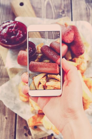 Using smartphones to take photos of Fried Potatoes and grilled s