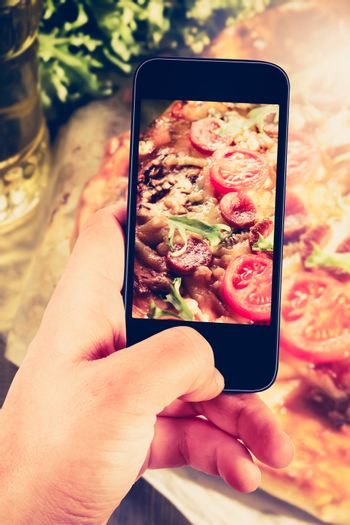 Using smartphones to take photos of pizza with instagram style f