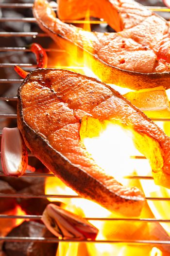 Salmon steak with vegetable on a grill
