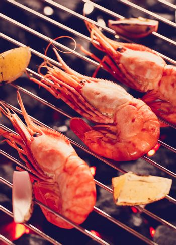 Three Shrimp on a grill with instagram style filter