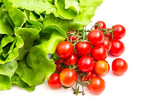 Cherry tomatoes and lettuce on white background