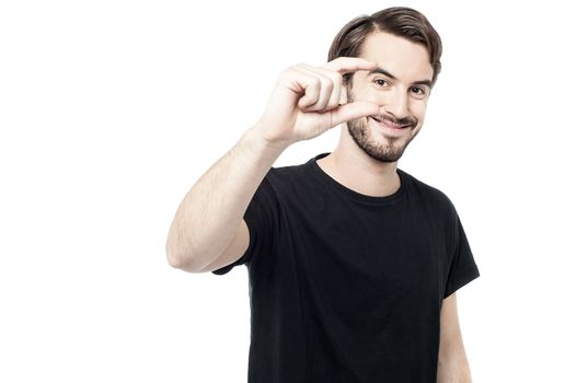 Man showing small amount with fingers