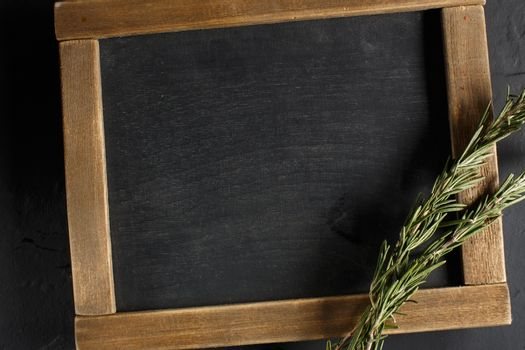 Herbs and spices with chalk board for text or recipes.