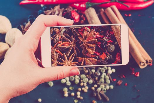 Using smartphones to take photos of herbs and spices. In the sty