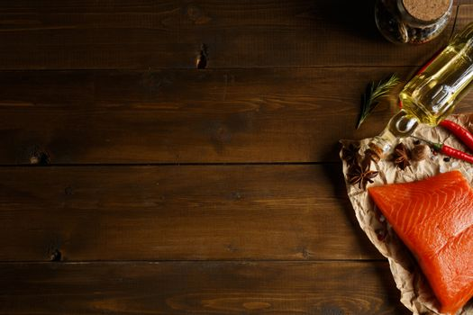 Salmon steak with herbs on wooden background with space for text
