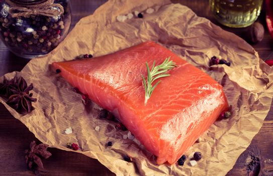 Salmon steak on old paper. In the style of instagram filter.