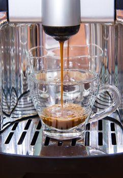 Espresso coffee machine makes coffee while
