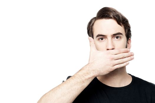 Man cover his mouth,  speak no evil concept.