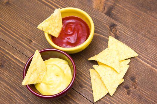 Nachos sauces on wooden table