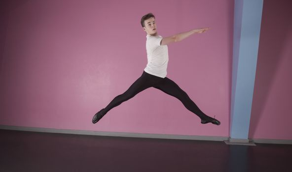 Focused male ballet dancer leaping
