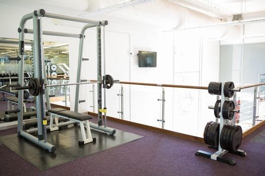 Empty weights room with bench press