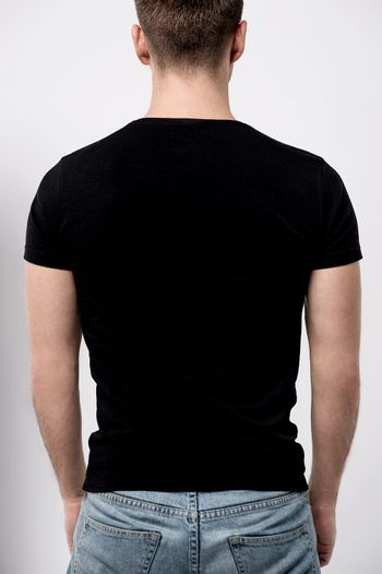 Back pose of young man, looks ahead