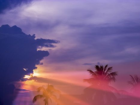 Colorfull Sunset with multy color..blue,orange,purple,red,sunlight and Sunrays coming out to the earth