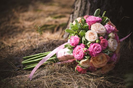 wedding bouquet from different rose color roses