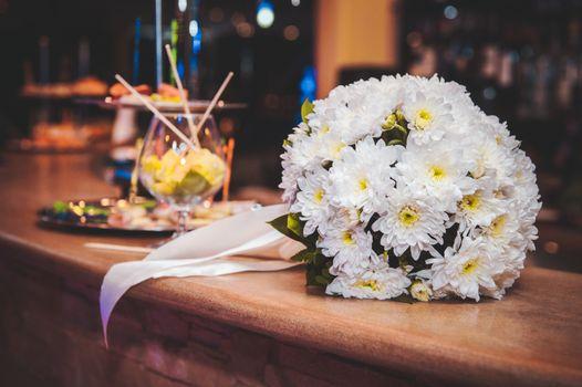 beautiful white wedding bouquet with white ribbon