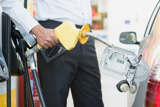 Pumping gasoline fuel