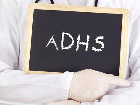 Doctor shows information on blackboard: adhs