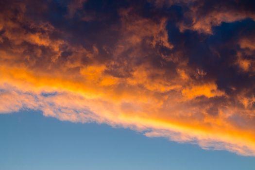 Stormcloud over blue sky