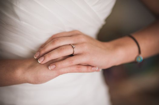 hands of bride with wedding ring on
