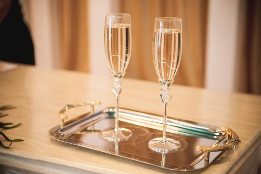 wedding champagne glass with hearts  full of drink