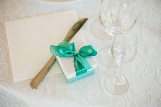 wedding gift box with green bow on table