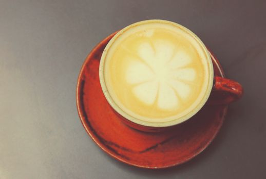 Cappuccino or latte coffee with retro filter effect
