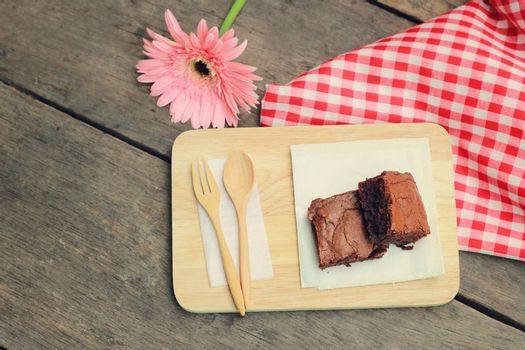 Tasty brownies with wooden spoon and fork, retro filter effect