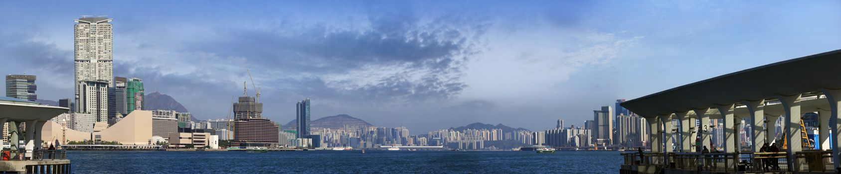 Hong Kong, Hong Kong S.A.R. - JENUARY 29, 2014: Star ferry crossing the Victoria Harbor with a view of Hong Kong Island skyline in the background.