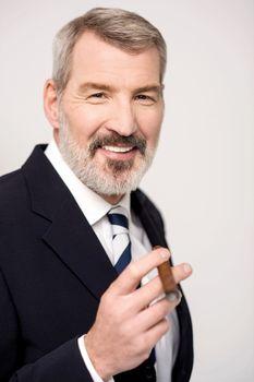 Happy businessman with cigar